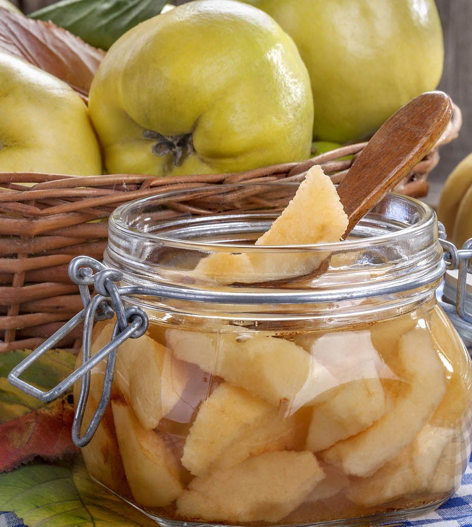 canned fresh and healthy quince on an old wooden table
